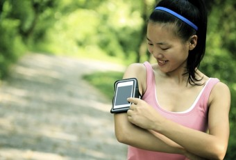 woman listening to music from smart phone mp3 player