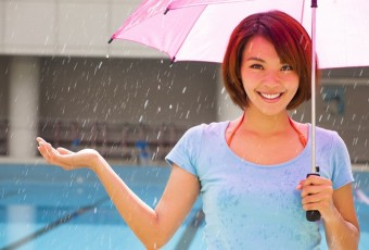 smiling young woman with rain