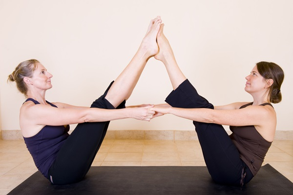 Two adult ladies doing yoga