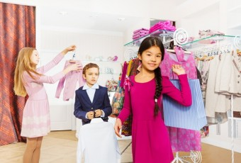 Children standing together in the clothing store
