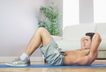 Sporty handsome man doing sit ups