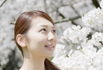 Cherry blossoms and smiling woman