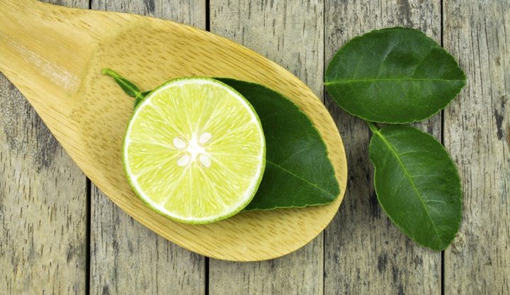 lime slice and leaf on wood padle