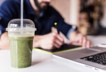 Healthy Smoothie on Graphic designer's working table