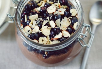 Blueberries with hazelnuts on chocolate pudding in a jar