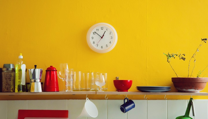 Yellow wall clock in the kitchen