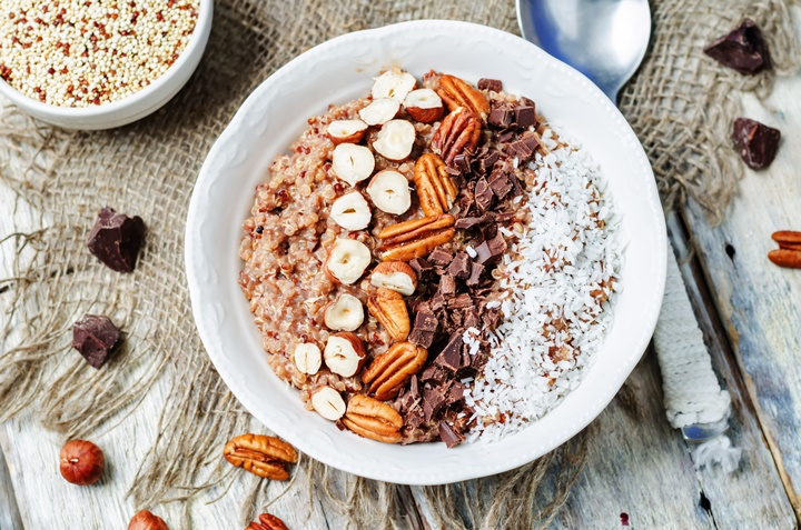 Chocolate Quinoa breakfast bowl decorated with hazelnuts, Pecan, chocolate and coconut