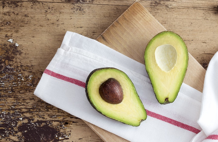 Avocado on rustic wooden background