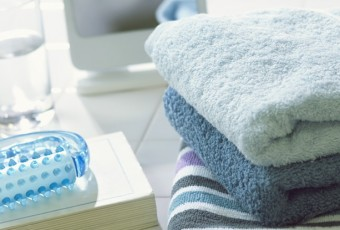 Book, towels, and a massaging tool