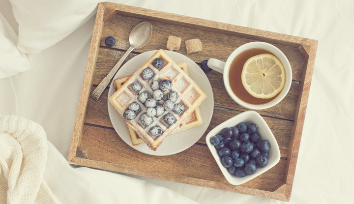 breakfast in bed, tray with belgian waffles with blueberry and