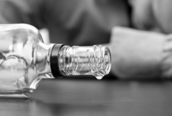 Almost empty bottle of alcohol
