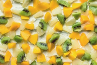 Colorful fruit background texture from fruit slices - kiwi, pine