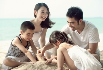 Asian family on the beach