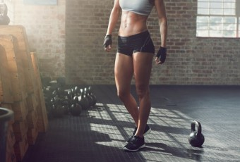 Muscular woman standing in gym