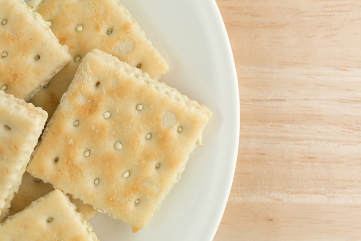 Cream cheese and chives crackers on a white plate