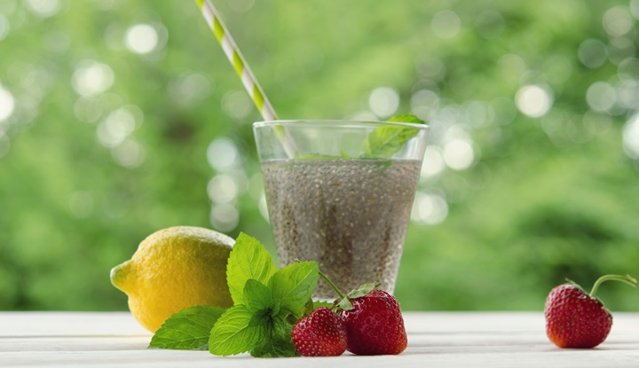 Chia seeds drink in glass with lemon, mint and strawberry