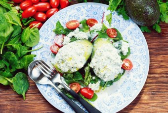 Avocado halves stuffed with cottage cheese and vegetables
