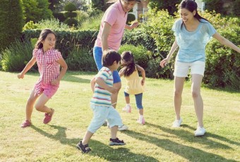 Asian Family Playing In Summer Garden Together