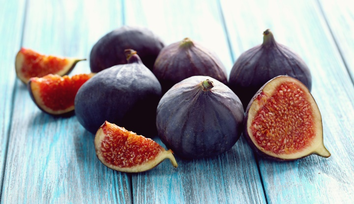 Fresh figs on a blue wooden table
