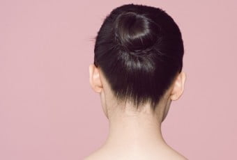 Back view of woman with hair in bun