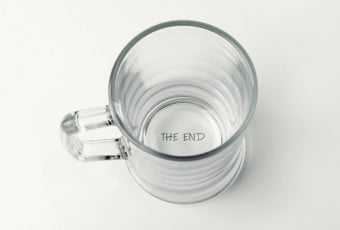 """empty beer cup with """"the end"""" text on the bottom"""