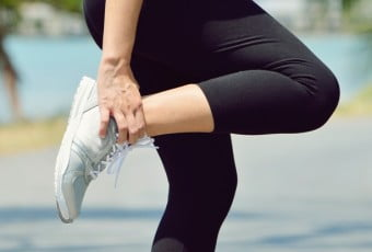 Female runner leg and muscle pain during running outdoors