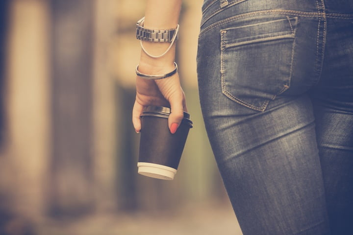 Attractive woman holding cup of coffee.