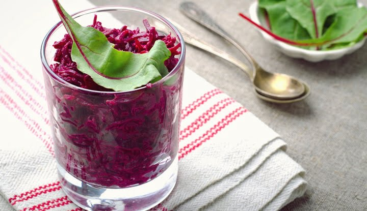 Fresh beet salad with chard leaves in glasses on linen