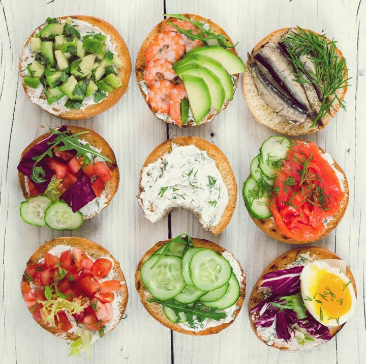 Small sandwiches on wooden background