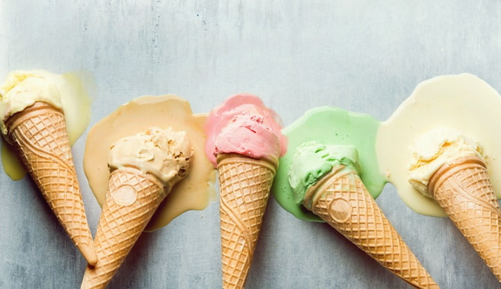 Colorful ice cream cones of different flavors. Melting scoops. Top