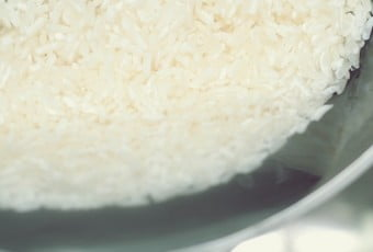A close-up of white rice being washed