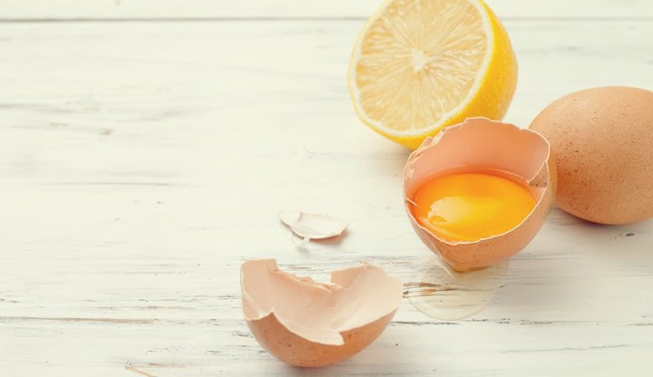 eggs, lemon to prepare homemade food and cosmetics on whitte