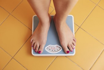 Pair of female feet on a bathroom scale