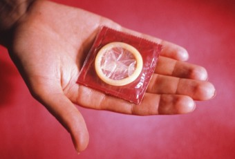 Person showing condom, Close-up of hand