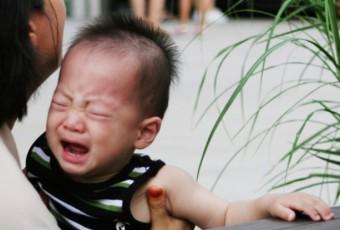 Asian boy crying