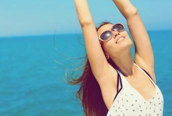 Summer vacation. Happy woman enjoying the sun.