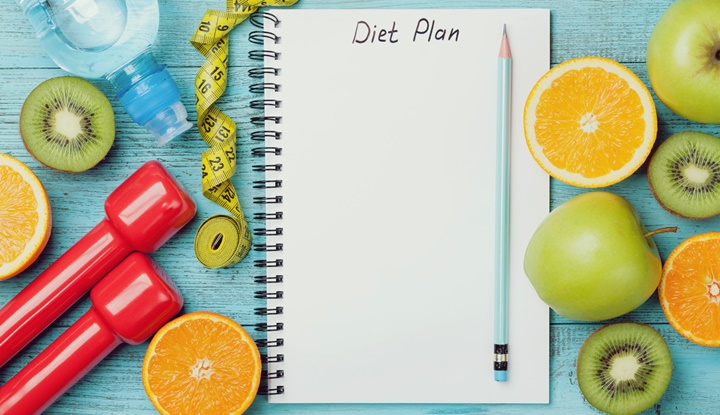 Diet plan, tape measure, water, dumbbells and fruits, detox concept