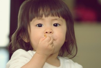 Japanese baby girl eating cereal (1 year old)