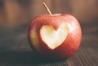 Apple with a heart cut into it
