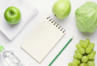 Fitness workout routine blank notebook and diet concept