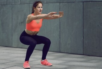 Fit young woman doing squats