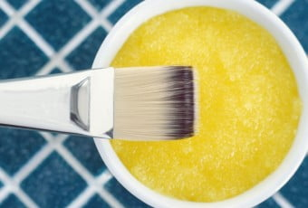 Yellow cosmetic mask (scrub) in a bowl