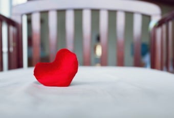 Heart in baby's crib